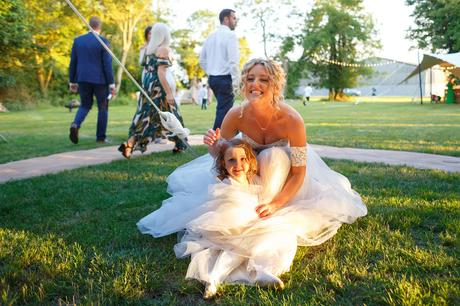 the bride and child in the sunlight