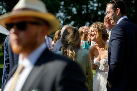 the bride smiling in the summer sunshine