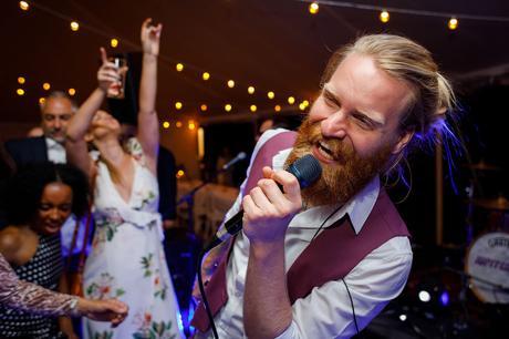 jupiter ray sing at a summer solstice wedding