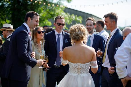 the bride talks to her guests