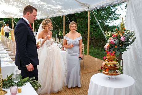 polly and steve check their wedding cake
