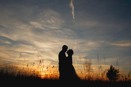 bride and groom in a summer solstice wedding sunset silhouette