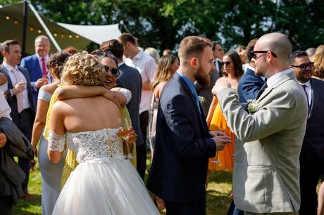 the bride hugs one of her guests