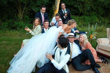 the bride dives onto a group of guests