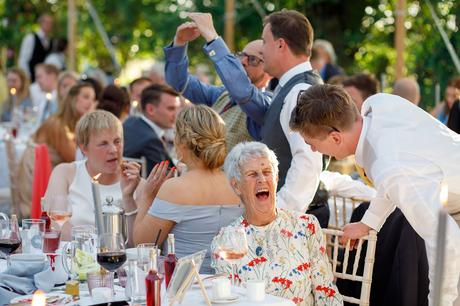 a laughing wedding guest