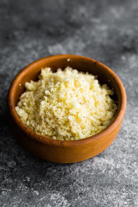 Parmesan Cauliflower Rice in wooden bowl