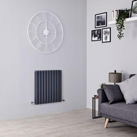 Milano Aruba designer radiator on a gray wall.