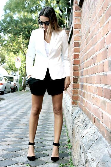 white blazer and black shorts