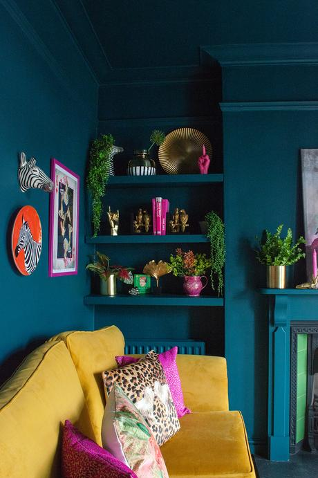 Teal and mustard living room. Colourful, maximalist decor inspiration with quirky prints and home accessories from Audenza.