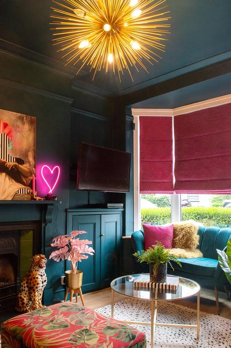 Teal and fuschia color palette inspiration. Dark and moody living room decor.