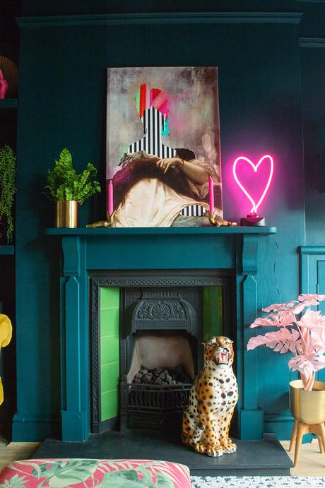 Eclectic living room inspiration. Teal walls paired with colourful art and quirky accessories.