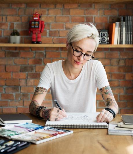 Tattooed women sketching