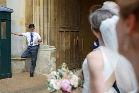 a porter talks to the bride and groom