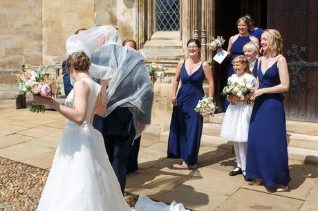 the brides veil blows in the wind