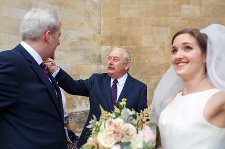 the grooms father congratulates his son