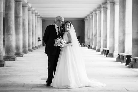 bride and groom in the cloisters at a trinity college wedding