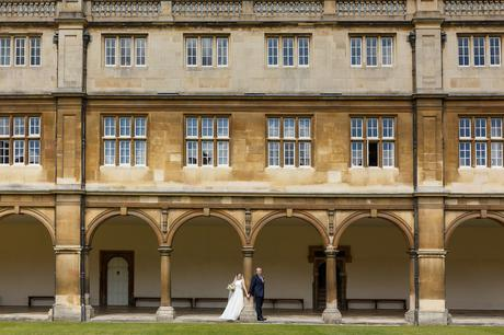 bride and groom pose in the cloisters