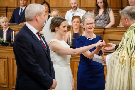 the mother of the bride passes her daughters hand
