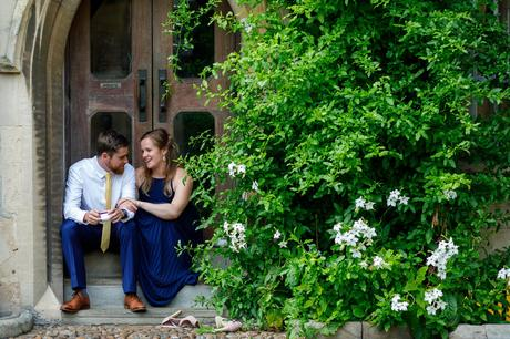a bridesmaid and her man sit outside