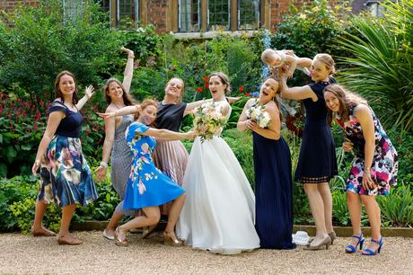 the bride and her friends pose