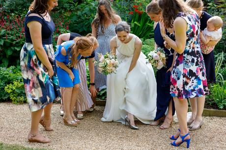 the bride shows off her shoes