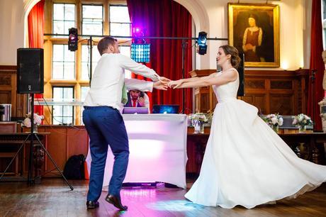 the bride dances with a guest