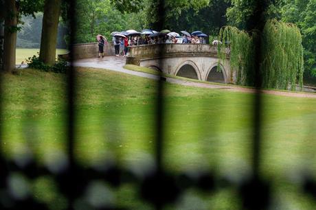 tourists walking over trinity college bridge