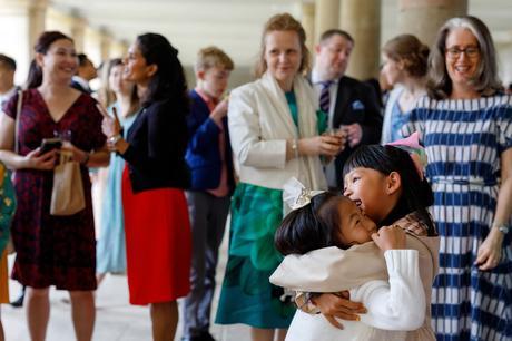 young wedding guests hug