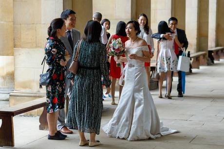 the bride greets her guests at a trinity college wedding