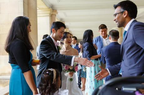 the groom greets his guests