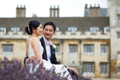 a wedding couple at trinity college cambridge