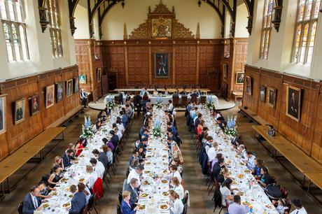 Trinity college dining hall laid out for a wedding