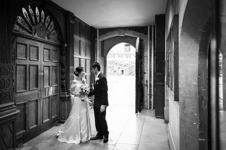 bride and groom share a moment outside the dining hall