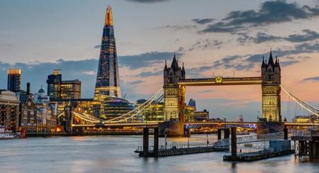 Enchanting Travels UK & Ireland Tours The Tower Bridge in London after sunset with the Shard in the back