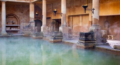 Enchanting Travels UK & Ireland Tours Steam rising off the hot mineral water in the Great Bath, part of the Roman Baths in Bath, UK