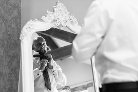 the groom gets ready for the wedding