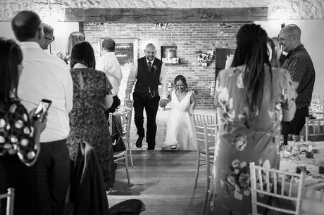 bride and groom enter the barn at hautbois hall