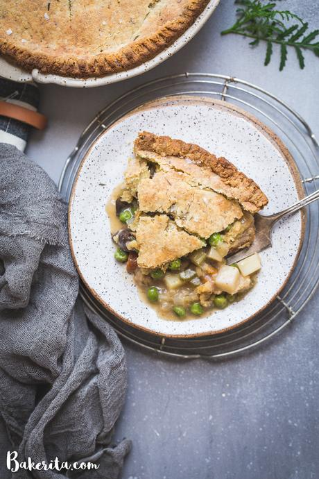 This Vegan Pot Pie has a scrumptious flaky gluten-free & paleo crust and the creamy filling is absolutely loaded with vegetables! This hearty, filling meal is perfect for chilly days and freezes well.