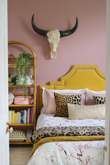 Blush pink bedroom with leopard print home accents