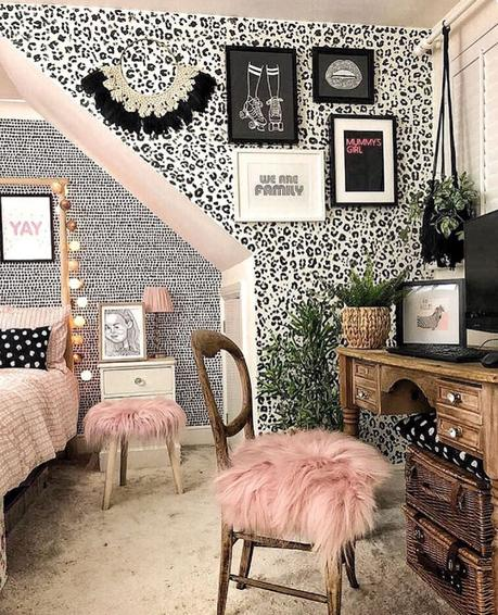 Feminine bedroom inspiration with monochrome leopard print wallpaper and blush pink accents.