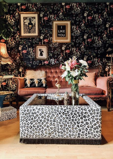 Bold, floral wallpaper combined with monochrome animal print furniture.
