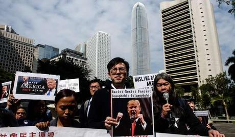 Members of the League of Social Democrats of pro-democracy party Avery Ng (C), Leung Kwok-hung also known as Long Hair (centre R) and other activists take part in a protest against US President Donald Trump and his recent immigration and refugee restrictions, in Hong Kong. Photo: AFP