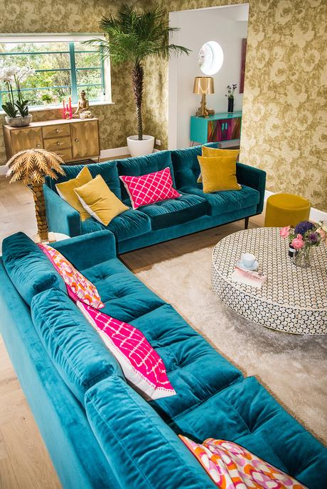 Eclectic living room inspiration with blue velvet sofas and gold accessories