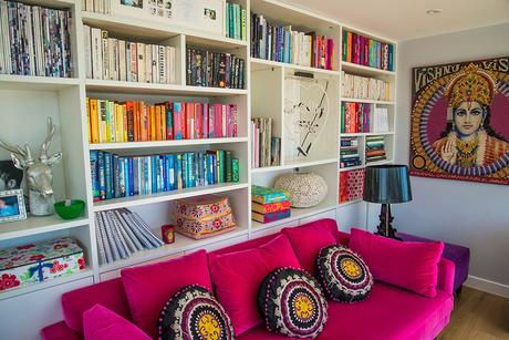 Reading nook with hot pink velvet sofa