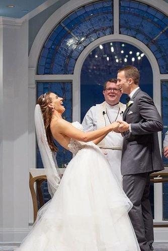 funny wedding vows newlyweds laughing at the wedding ceremony