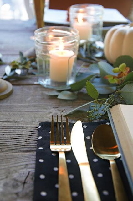 a Halloween tablescape with a mystery book theme