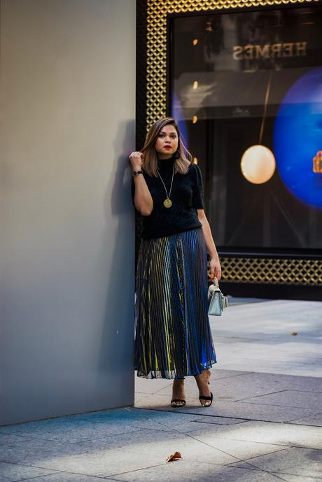 festive outfit, pleated midi skirt, metallic midi skirt outfit, metallic sparkly kate spade sweater, party sweater, black strappy sandals, party outfit, fall fashion, street style, myriad musing, saumya shiohare