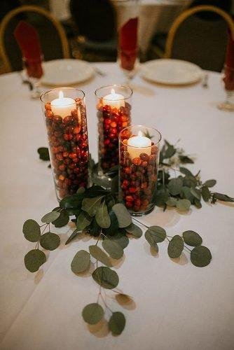 christmas wedding ideas wedding centerpiece with cranberries candles
