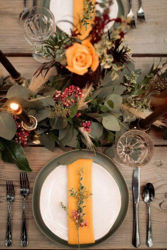 wedding colors 2019 moody dark bohemian table with candles and mustard roses and leaves century tree productions