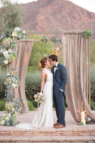 wedding colors 2019 dusty pink arch with cloth succulents and hanging geometry amy and jordan photography